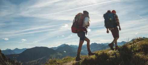 hiking uphill with backpacks