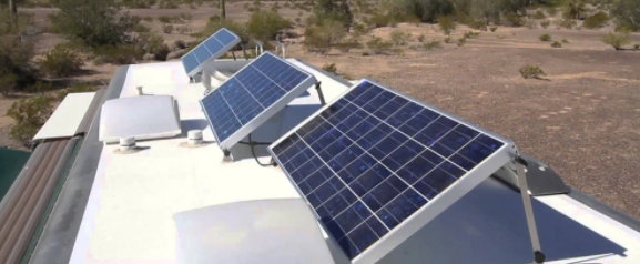 angled solar panel on top of rv roof in the desert