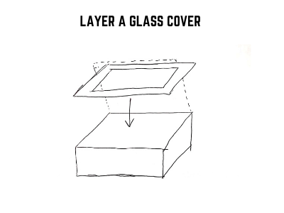 layer a glass cover to the shoe box solar oven